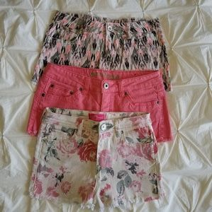 Three pink colored shorts